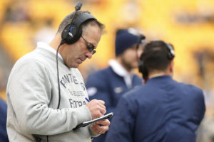 Pittsburgh head coach Pat Narduzzi takes notes on the sideline during the first half of an NCAA college football game against Syracuse in Pittsburgh, Saturday, Nov. 26, 2016.(AP Photo/Jared Wickerham)