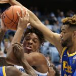 Terrell Brown and Onyebuchi Ezeakudo smother North Carolina center Armando Bacot.